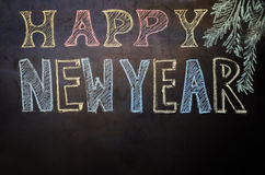 Guten Rutsch ins Neue Jahr geschrieben mit Kreide auf einen schwarzen Hintergrund Stockfotos