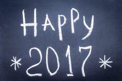 Guten Rutsch ins Neue Jahr geschrieben mit Kreide auf einen schwarzen Hintergrund Lizenzfreie Stockfotografie