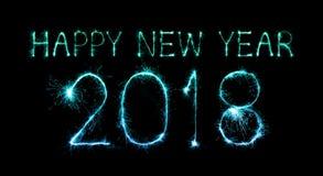Guten Rutsch ins Neue Jahr 2018 geschrieben mit Scheinfeuerwerk Stockbilder