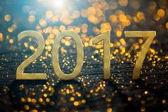 2017-guten Rutsch ins Neue Jahr-Hintergrund mit Goldlichthintergrund Lizenzfreies Stockbild