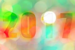 Guten Rutsch ins Neue Jahr 2017 im abstrakten bokeh des Lichtes Stockfotografie