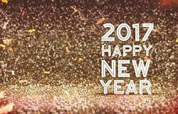 2017 guten Rutsch ins Neue Jahr im Goldfarbzusammenfassungs-Funkelnhintergrund, H Stockbilder