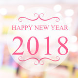 Guten Rutsch ins Neue Jahr 2018-jährig auf schönem Unschärfehintergrund Einkaufsm Stockfotos