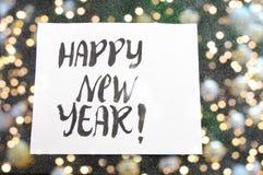 Guten Rutsch ins Neue Jahr-Karte mit Weihnachtsdekoration Lizenzfreies Stockbild