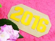 Guten Rutsch ins Neue Jahr-Konzeptdekoration mit künstlicher Blume Stockfoto