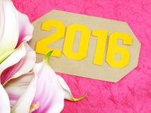 Guten Rutsch ins Neue Jahr-Konzeptdekoration mit künstlicher Blume Stockfotos