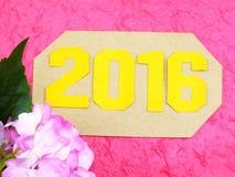 Guten Rutsch ins Neue Jahr-Konzeptdekoration mit künstlicher Blume Lizenzfreies Stockbild
