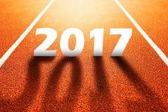 2017 guten Rutsch ins Neue Jahr, Leichtathletiksport-Laufbahnkonzept Lizenzfreies Stockbild