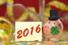 Guten Rutsch ins Neue Jahr 2016 mit Glücksbringer Lizenzfreies Stockfoto