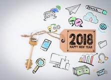 2018 guten Rutsch ins Neue Jahr Schlüssel und eine Anmerkung über einen weißen Hintergrund Lizenzfreies Stockbild