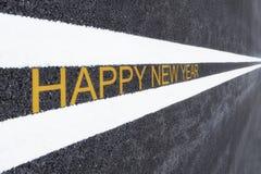 Guten Rutsch ins Neue Jahr-Wörter auf Asphaltstraße Lizenzfreie Stockfotos