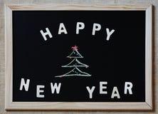 Guten Rutsch ins Neue Jahr-Weihnachtsbaum auf Tafel Lizenzfreies Stockbild