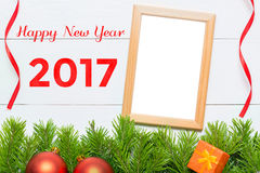 Guten Rutsch ins Neue Jahr 2017 Weihnachtsdekoration und Fotorahmen Stockbild
