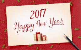 2017-guten Rutsch ins Neue Jahr-Wort auf Papierhandwerk der alten Weinlese mit Geschenk Stockbilder