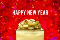 Guten Rutsch ins Neue Jahr-Wort mit goldener Geschenkbox mit Band und colorfu Stockfotos