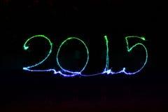 Guten Rutsch ins Neue Jahr - Wunderkerze 2015 Lizenzfreie Stockfotos