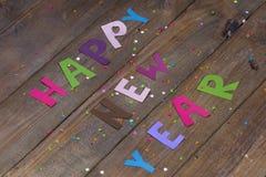 Guten Rutsch ins Neue Jahr-Zeichen von farbigen Buchstaben Lizenzfreie Stockfotos