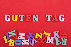 GUTEN TAG word on red background composed from colorful abc alphabet block wooden letters, copy space for ad text Royalty Free Stock Images