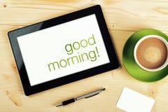 Gutenmorgen-Mitteilung auf Tablet-Computer-Schirm Lizenzfreies Stockbild