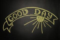 Guter Tag mit der Band-Fahne, geschrieben mit Kreide auf eine Tafel Stockfotos