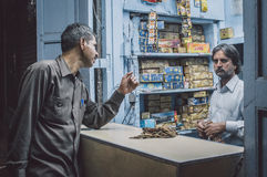 Gutka shop. JODHPUR, INDIA - 16 FEBRUARY 2015: Indian vendor sells gutka to customer. Gutka has mild stimulant effect and is consumed by sucking and chewing Stock Photo