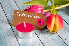 Gutschein - the german word for coupon. Gutschein inscription written on paper tag Royalty Free Stock Images