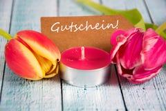 Gutschein - the german word for coupon. Gutschein inscription written on paper tag Stock Photo