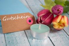 Gutschein - the german word for coupon. Gutschein inscription written on paper tag Royalty Free Stock Photo