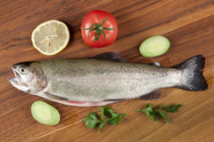 Gutted fish trout on a cutting board Royalty Free Stock Images
