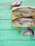 Gutted trout on a bright wooden background. Royalty Free Stock Photo