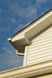Gutter. And down spout. Sharp focus on the second story  and down spout Royalty Free Stock Photos