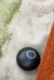 Gutter Ball. Vertical Image Of A Lawn Bowls Ball Lie In A Sand Gutter From A Rather Tragic Bowling Attempt Stock Image