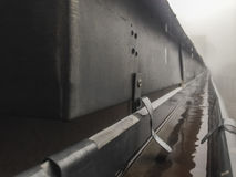 Gutter drainage system on the roof with dripping fog Royalty Free Stock Photography