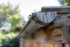 Gutter draining rainwater. The building is equipped with drainage of rainwater from the roof. royalty free stock photography
