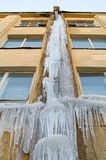 Gutter with ice. Many icicle on home gutter Stock Photo