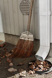 Gutter, leaves and broom Stock Photography