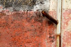 A gutter pipe on a grunge wall Stock Images