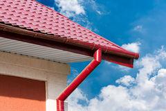 Gutter and red tiled roof stock photos