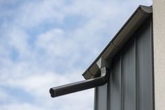 Gutter on the roof royalty free stock photo
