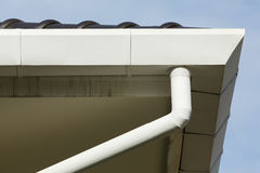 Gutter on roof top residential building Royalty Free Stock Images