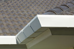 Gutter on roof top residential building Royalty Free Stock Photos