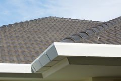 Gutter on roof top residential building Stock Images