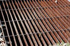 Gutters drain grate, drain cover. Road drains - sewer cover. iron grate of water drain on the road in every city. Water go down to stock images
