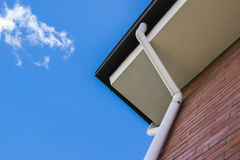 Gutters on eaves of brick building Royalty Free Stock Photography
