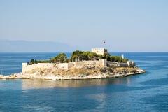 Guvercin Ada, (Pigeon Island) with Kusadasi Castle, Kusadasi, Turkey. The island of Guvercin Ada, at Kusadasi, Turkey. The island is connected to Kusadasi via a Royalty Free Stock Photos