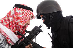 Guy. Terrorist and a soldier holding gun Royalty Free Stock Photos