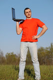 Guy. In red t-shirt with notebook Royalty Free Stock Image