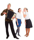 A guy with an accordion and two girls Royalty Free Stock Image