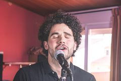 Guy with afro hair singing stock images