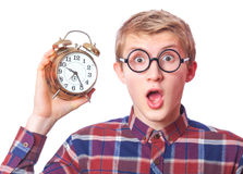 Guy with alarm clock. Nerd guy with alarm clock. Isolated Royalty Free Stock Photography